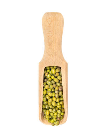 Green mung beans in wooden scoop on white background, top view