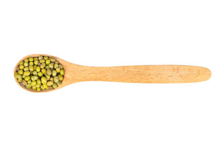 Spoon with dried green mung bean isolated on white background, top view