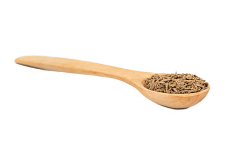 Dry cumin seeds in spoon isolated on white background Stock Photo