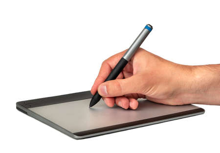 Mens hand with pen and graphic tablet on white background Stockfoto