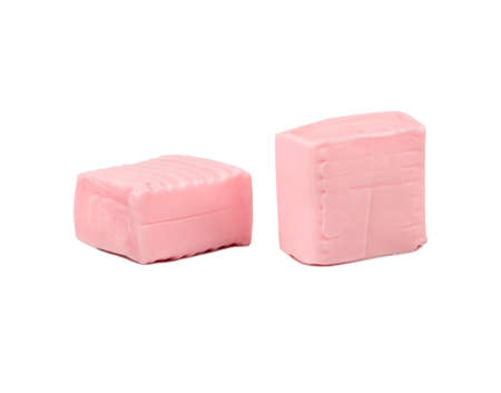 Two square chewy candies on white background Фото со стока