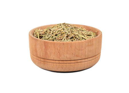 Wooden bowl with dry rosemary isolated on white background