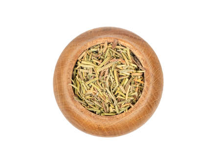 Dry rosemary in wooden container isolated on white background, top view Stock Photo