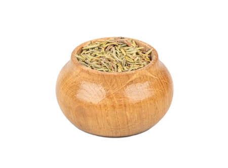 Dry rosemary in wooden container isolated on white background Stock Photo