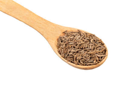 Dry cumin seeds in spoon closeup on white background Stock Photo - 124715442