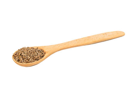 Wooden spoon with dry cumin isolated on white background