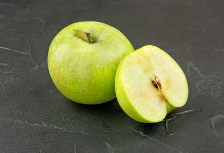 Fruit green apple with half on concrete background