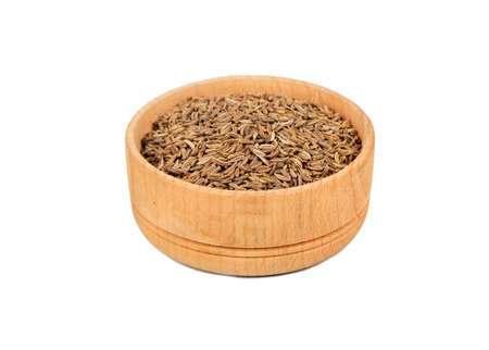 Dry cumin in wooden bowl isolated on white background Фото со стока - 129712208