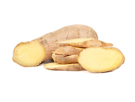 Fresh ginger root with slices on white background