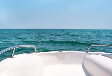View of the waves of the black sea from the deck of the boat on a summer day Фото со стока