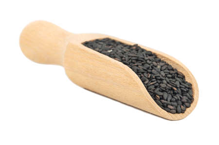 Wooden scoop with black sesame seeds isolated on white background