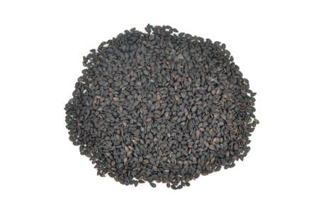 Pile of black sesame isolated on a white background, top view Фото со стока