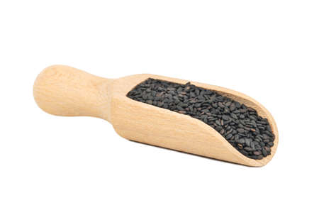 Black sesame in wooden scoop isolated on white background Stockfoto