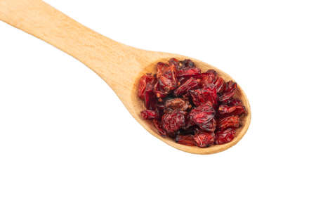 Small spoon with dry barberry isolated on white background closeup Stockfoto