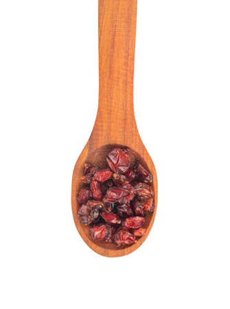 Wooden spoon with dry red barberry on white background, top view Stockfoto