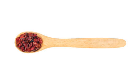 Small spoon with dry barberry isolated on white background, top view