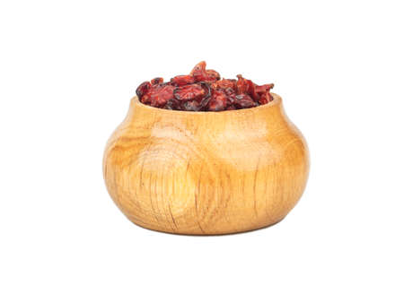 Dry barberry in wooden container isolated on white background