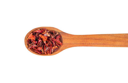 Wooden spoon with pieces of dry red pepper on white background, top view