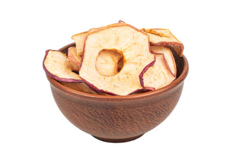 Apple chips in ceramic bowl on white background