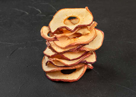 Stack of dry Apple chips on a concrete background Banco de Imagens
