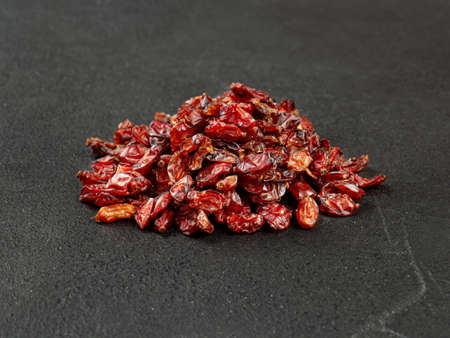 Pile of dry barberry on a dark background