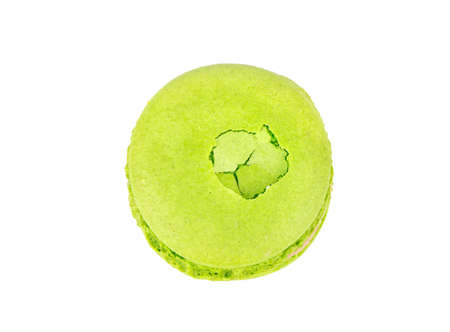 Pistachio green macaroon with dent isolated on white background 写真素材