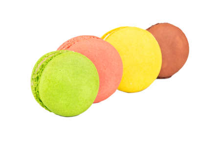 Delicious four colored macaroons on a white background