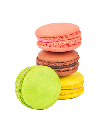 Four multicolored macaroons on a white background