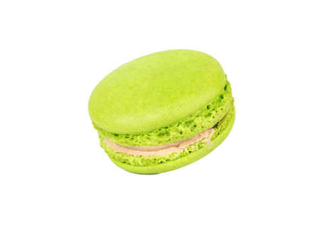 Green pistachio macaroon isolated on white background