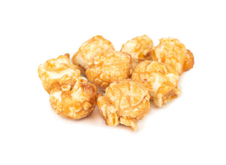 Several popcorn in caramel on a white background