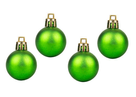 Four green Christmas balls isolated on white background