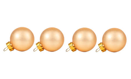 Four beige Christmas balls isolated on white background