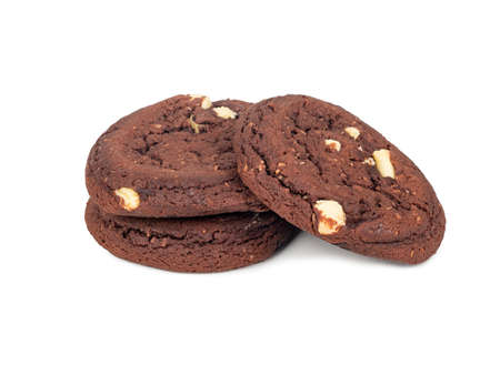 Three chocolate cookies with coconut slices on a white background