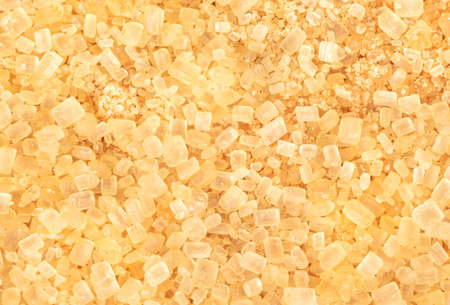 Background of scattered brown sugar close up 스톡 콘텐츠