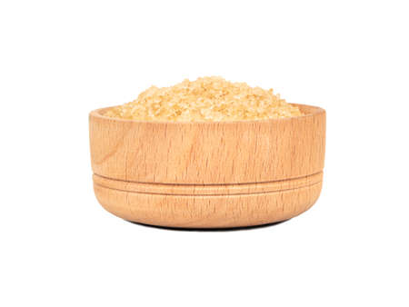 Wooden bowl with brown sugar isolated on white background