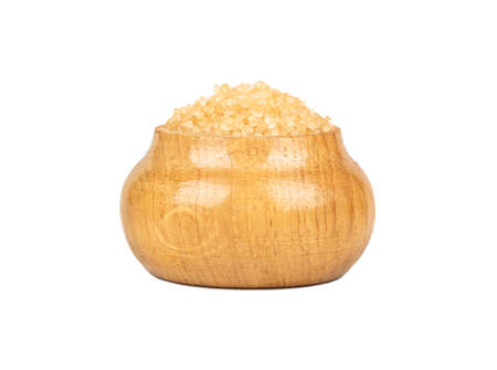 Brown sugar in a wooden container isolated on a white background