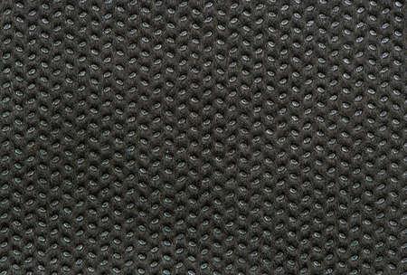 Black fabric background close up