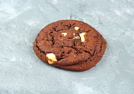 Homemade chocolate cookies on a light background