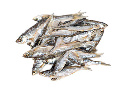Pile of dry small fish on a white background, top view