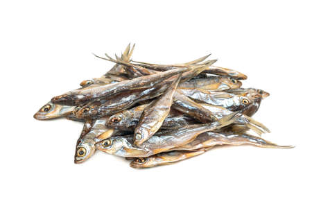 Pile of dry small fish on a white background Фото со стока