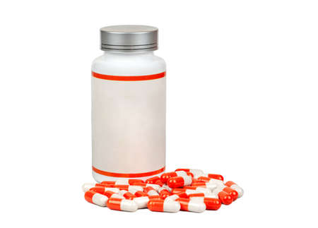 Plastic jar with scattered red capsules on a white background