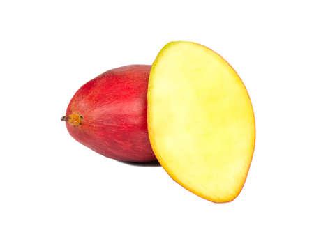 Mango fruit with juicy half on a white background