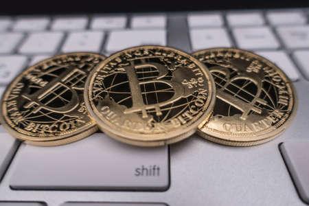 bitcoin souvenir coin on keyboard