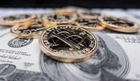 coins of bitcoin on dollar notes Stock Photo