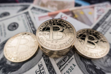 coins of bitcoin on dollar notes 写真素材