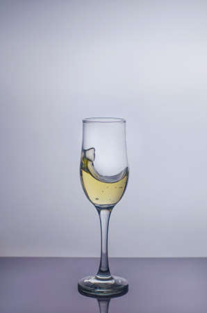 Splash in a glass of champagne. Stock Photo