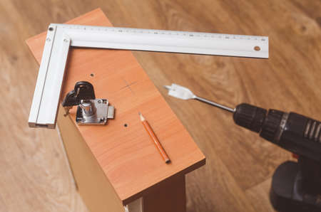 Installation mortise lock in the bedside table.