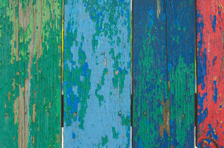 context: Wooden multicolored background with old paint.