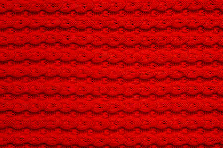 Pattern knitted fabric red color background texture.