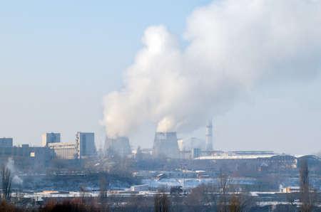 Thermal power plant with chimneys, industrial landscape. Standard-Bild - 116373389